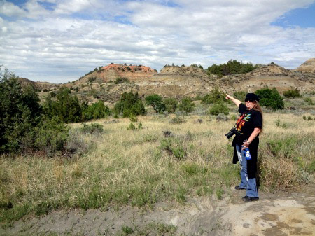 Karen Duquette pointing to famous rock formation at the Painted Canyon