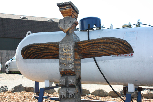 totem pole and propane tank