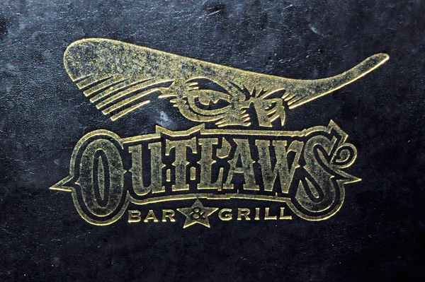 Outlaws Bar and Grill sign