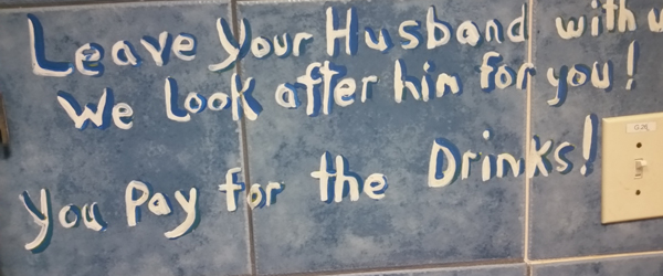 Sign on the walls in the Ladies Washroom