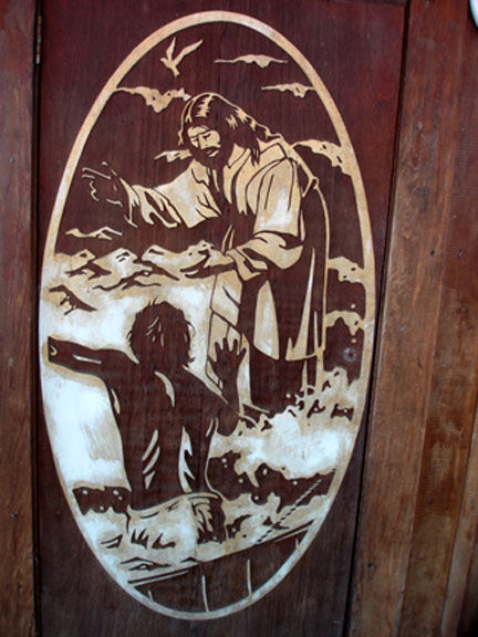 Carving on the door at the Outpost